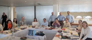 Mike Bracken and members of the treasury team in New South Wales, Australia